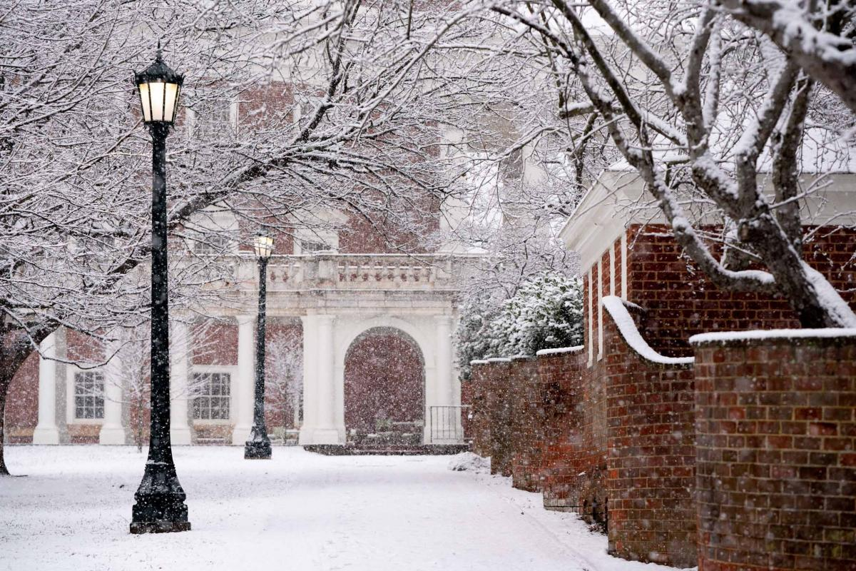 Snow falling and on UVA campus